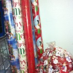 Christmas Fixings!Wrapping paper, gift tags, bows, tape and more! This basket will prepare you for the holidays ahead.